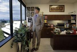 """Sam Miao, the Managing Director at the new AIG offices in San Mateo, Calif., on Monday, October 31, 2016. The company has opened a new office in San Mateo to sell insurance to Asians, primarily Asian americans and to a lesser extent, asian foreign nationals. All of its sales people must speak an asian language, and 95 percent are asian americans. Its office has what it calls a """"tea room"""" for clients and a lot of asian-themed artwork."""