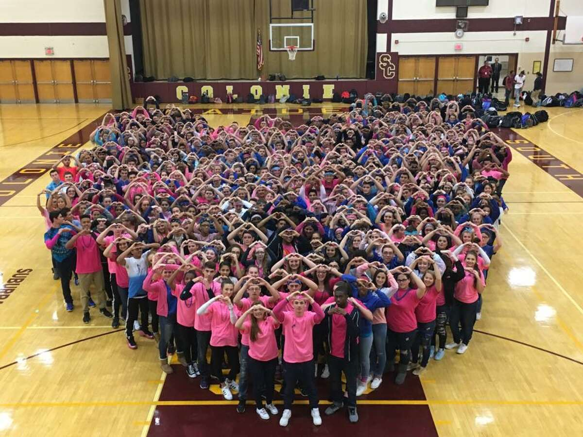 Students at Colonie Central High School pose for a photo in support of their classmate, Niko DiNovo, who was badly injured in a car crash Friday. (South Colonie school district photo)
