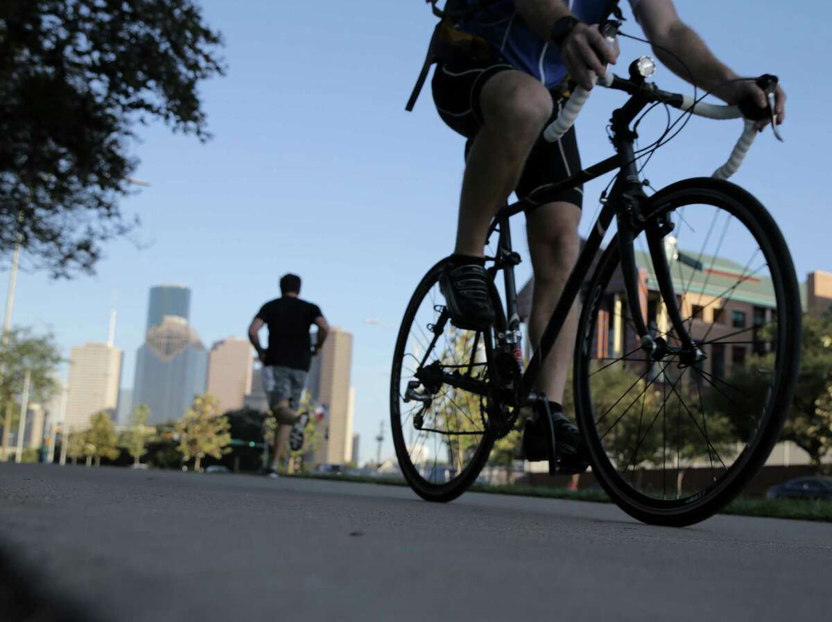 A cyclist rides from downtown during rush hour on Oct. 31. Fewer people are biking to work here.