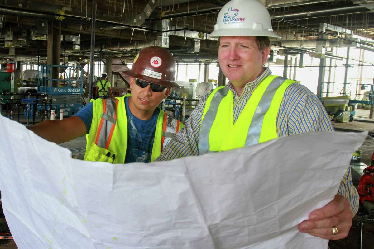 Hector Villatoro, left, and Hal Wychopen, of Texas Saffire, study a blueprint during the construction of the new Cypress-Fairbanks High School #12. (For the Chronicle/Gary Fountain, September 26, 2016)