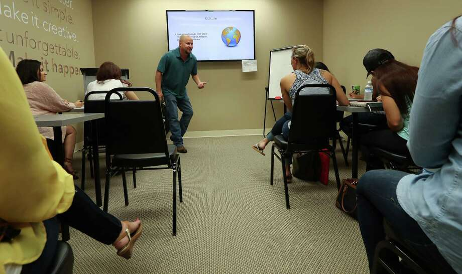 """Chance Brown (right) leads a Realty One Group Lone Star """"accountability session"""", where new real estate agents meet with their mentors to discuss goals and problems or successes Monday, Sept. 26, 2016, in Houston.  ( Steve Gonzales  / Houston Chronicle ) Photo: Steve Gonzales, Staff / © 2016 Houston Chronicle"""