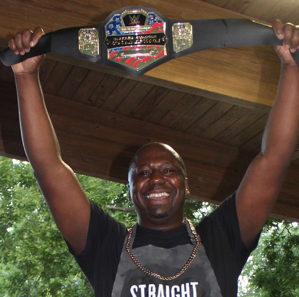 Derrick Taylor, manager of the Cypress Branch of the Associated Credit Union of Texas celebrates his win in the company's shrimp boil contest.
