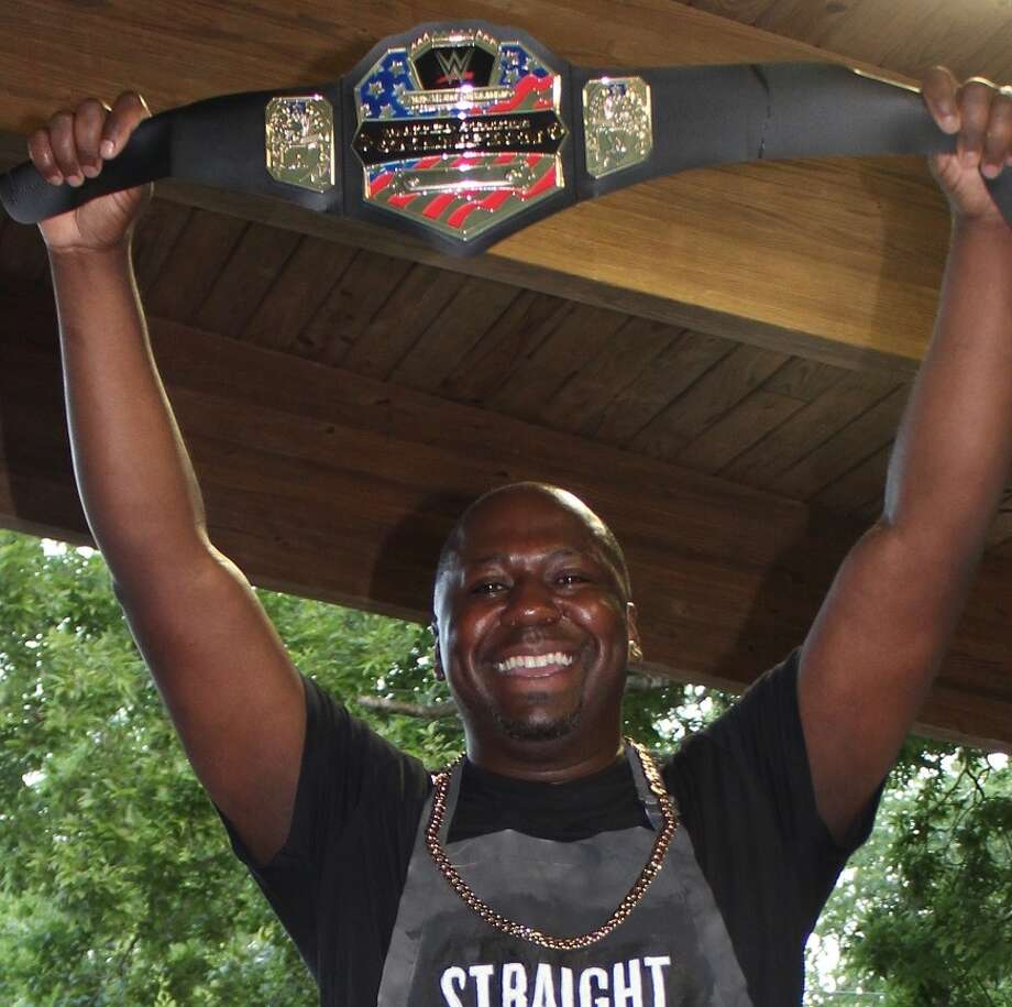 Derrick Taylor, manager of the Cypress Branch of the Associated Credit Union of Texas celebrates his win in the company's shrimp boil contest. Photo: Handout / All Rights Reserved