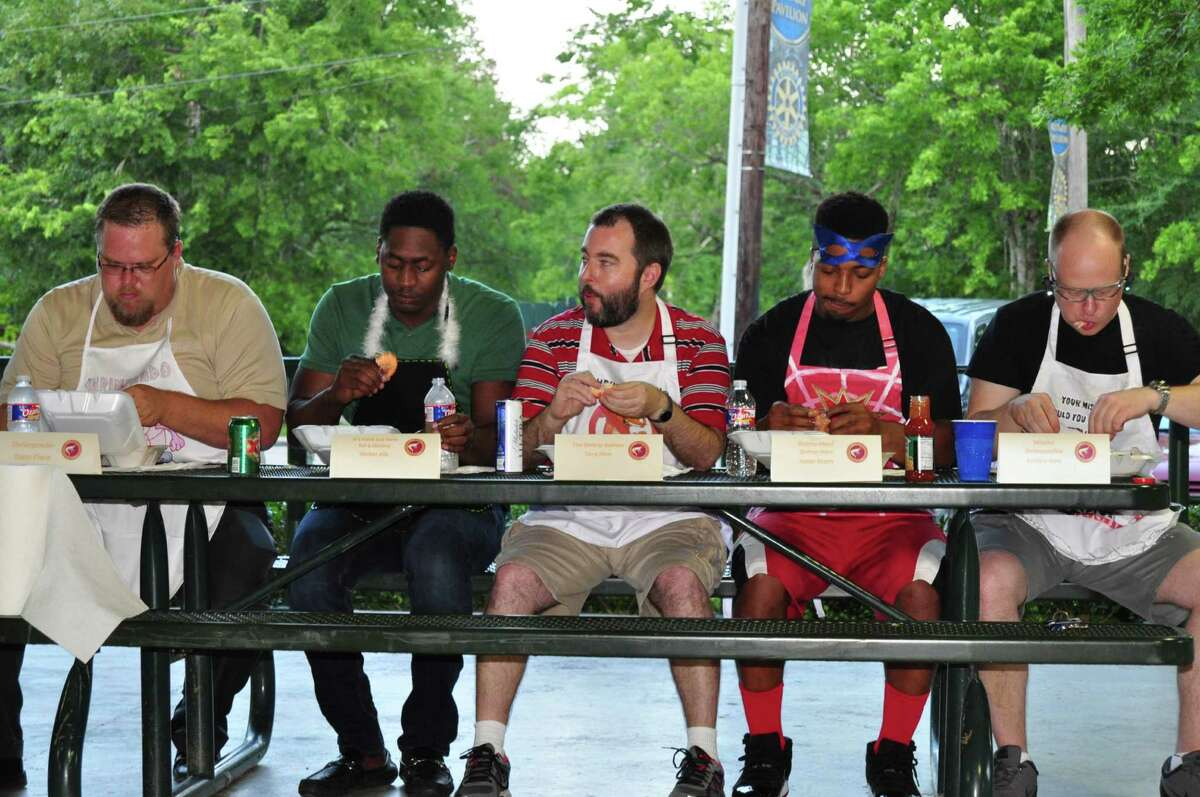 Associated Credit Union hosts a shrimp eating contest for employees. FromLeft to Right,Dana Place �- Mortgage Department,Walter Alix �- Texas City Branch,Tony Sims �- VP of Marketing,Xazier Murry �- Finance Department andAndrew Kent �- Legal Department