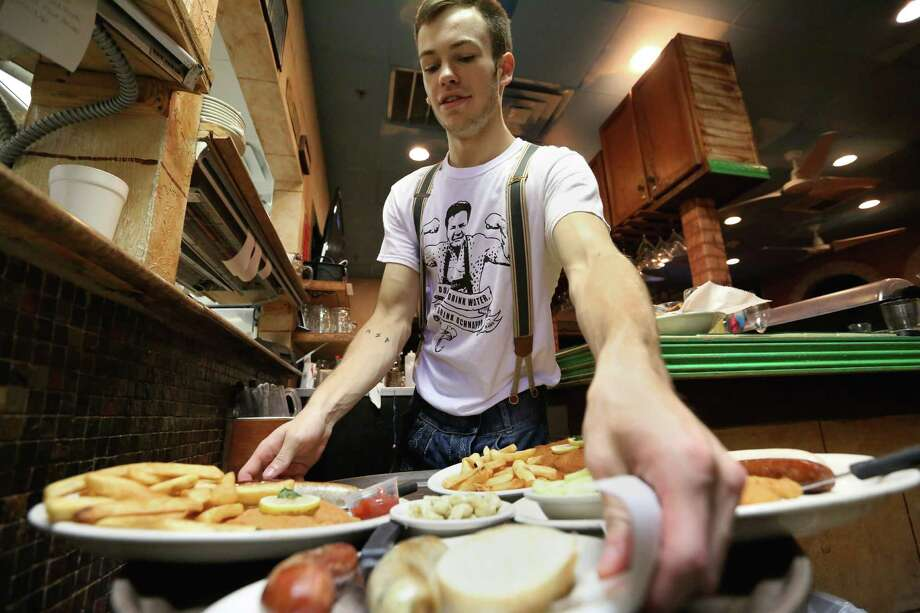 King's Biergarten & Restaurant employee Connor Idous prepares the food for guests Friday, Sept. 2, 2016, in Pearland. The restaurant is on the list again for Top Workplaces, in the small business category. ( Yi-Chin Lee / Houston Chronicle ) Photo: Yi-Chin Lee, Staff / © 2015  Houston Chronicle