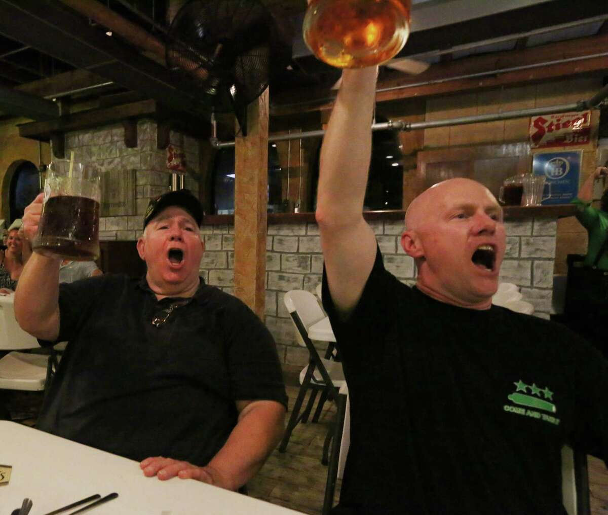 Jim Williams, left, and his son, Jason Williams, cheer with their beer at King's Biergarten & Restaurant Friday, Sept. 2, 2016, in Pearland. The restaurant is on the list again for Top Workplaces, in the small business category. ( Yi-Chin Lee / Houston Chronicle )