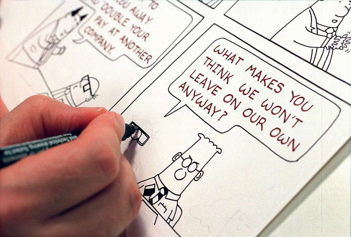 In this file photo, cartoonist Scott Adams works on a Dilbert comic strip in his Blackhawk home.