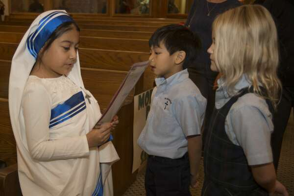 Bella Lara as Saint Mother Teresa gives her presentation about the Saint Tuesday 11-1-16 during St. Ann's living wax museum for All Saints Day. Tim Fischer/Reporter-Telegram