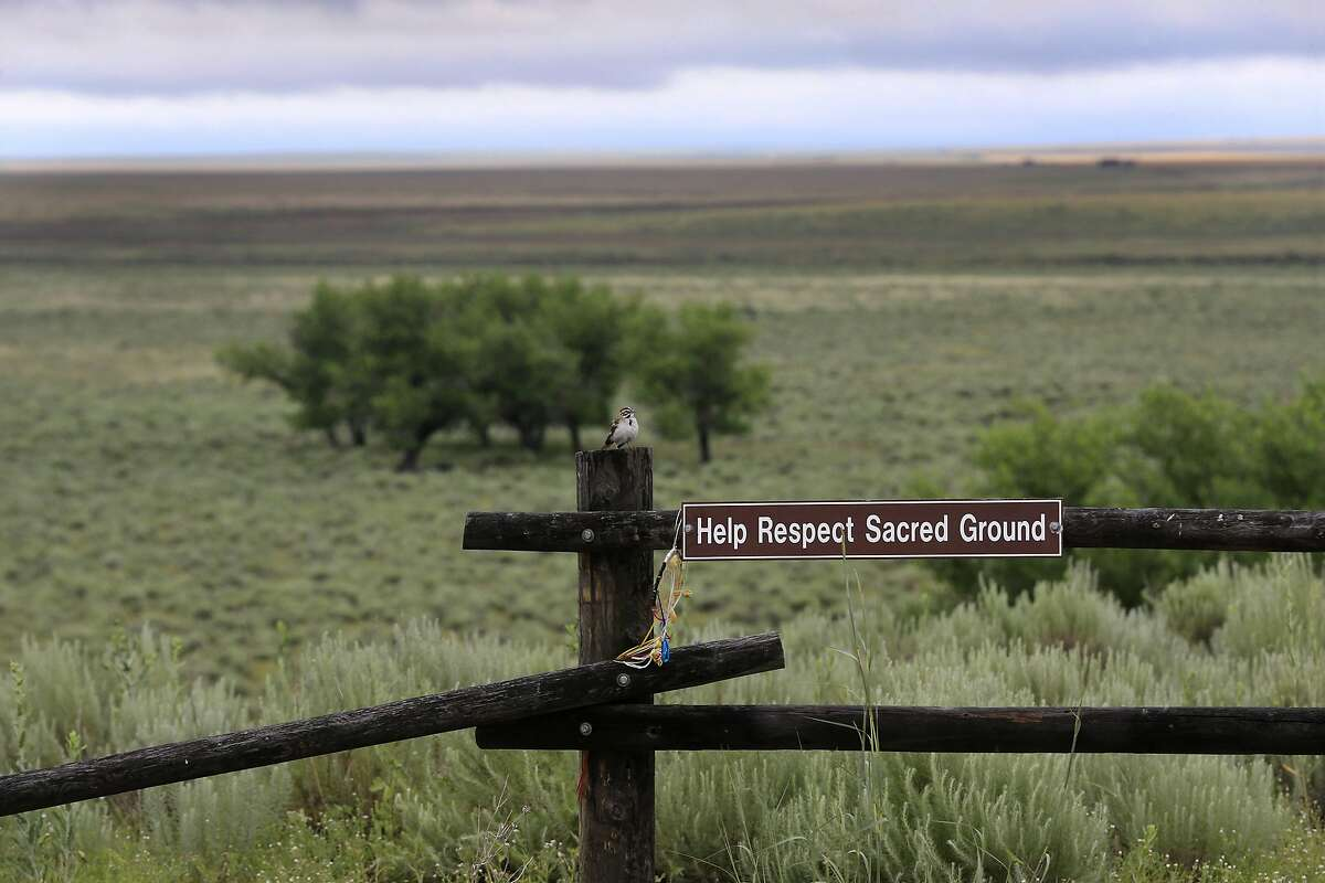 A bird rests on a fence post overlooking the area of where the massacre took place at sunrise at the Sand Creek Massacre National Historic Site on June 29, 2016 near Eads, Colo (Allen J. Schaben/Los Angeles Times/TNS)