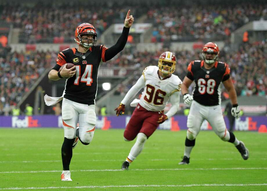 Cincinnati Bengals quarterback Andy Dalton (14) celebrates after scoring a touchdown during an NFL Football game against Washington Redskins at Wembley Stadium in London, Sunday Oct. 30, 2016. (AP Photo/Matt Dunham) Photo: Matt Dunham, Associated Press / Copyright 2016 The Associated Press. All rights reserved.