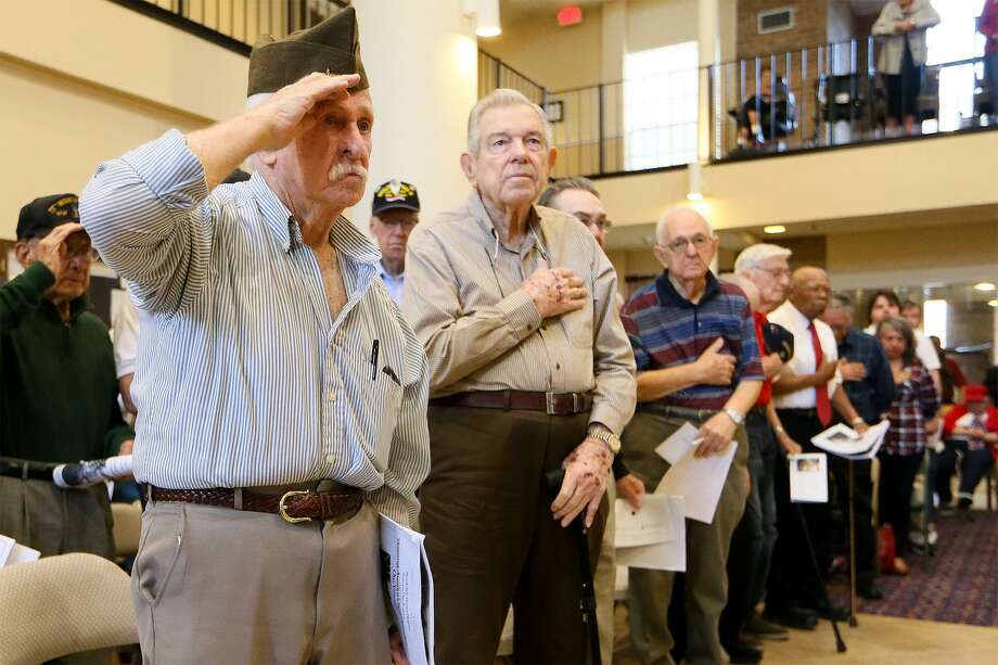 Jim Creswell (from left) and Tommy Tilley stand at attention with others as Taps are played during a Veteran's Day program at Brookdale Patriot Heights, 5000 Fawn Meadow, on Wednesday, Nov. 11, 2015.  The ceremony included honor guard from JBSA-Lackland and a roll call honoring veterans from the center.  MARVIN PFEIFFER/ mpfeiffer@express-news.net Photo: Marvin Pfeiffer, Staff / San Antonio Express-News / Express-News 2015