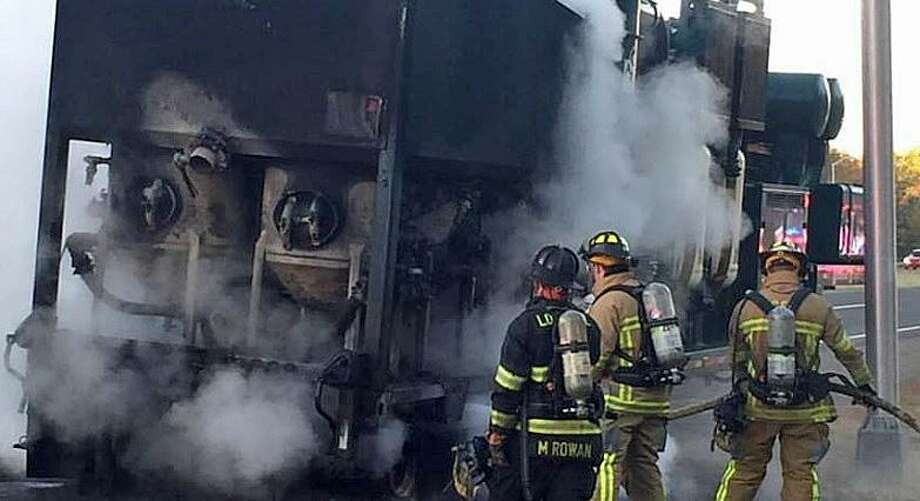 A truck fire blocked one southbound lane on Route 8 in Trumbull on Tuesday, Nov. 1, 2016. The Long Hill Volunteer Fire Department said the fire involved a construction trailer. Firefighters applied foam to the truck's burning tires. Photo: Long Hill Volunteer Fire Department Photo Via Facebook.