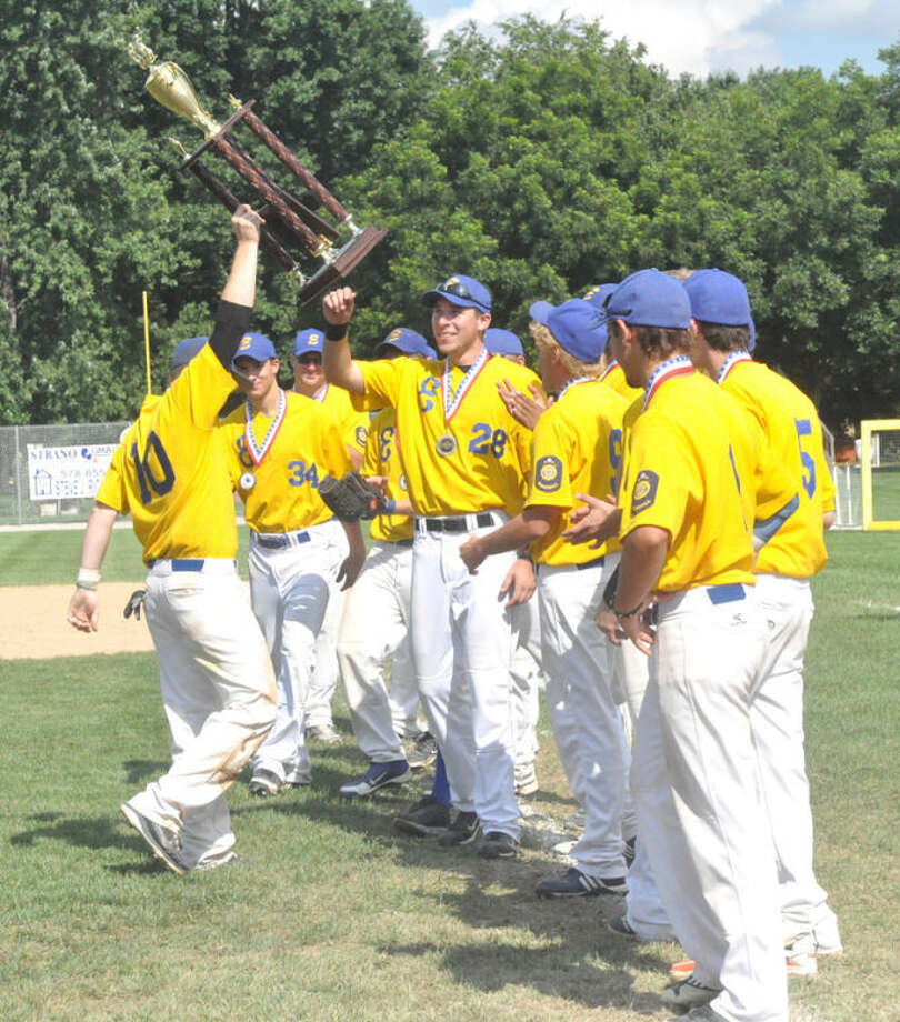The American Legion Post 199 baseball team celebrates with its Illinois state trophy in Trenton in August. Post 199 ended the season 37-8 and a win away from the American Legion World Series.