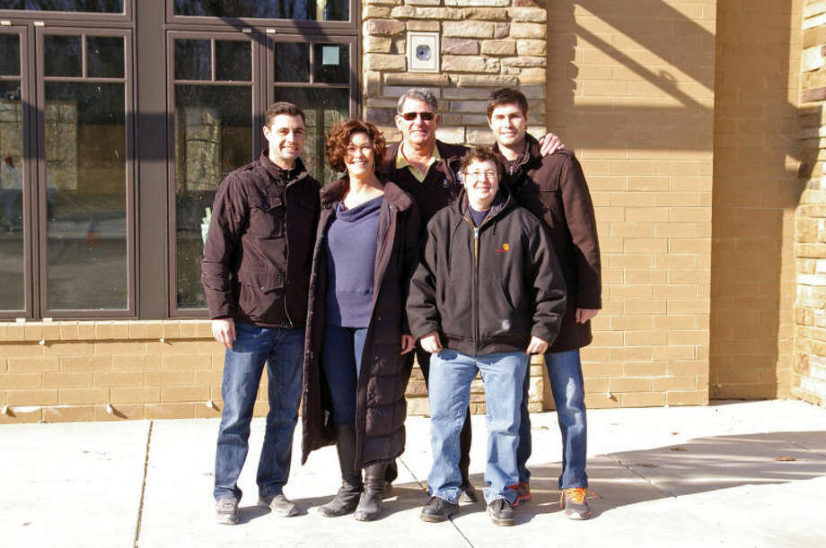 Pictured from left to right: Gary VanMatre co-owner; Pat Shannon-VanMatre co-owner,; Mike Shannon co-owner; Ginger Humphery executive chef and Justin VanMatre, restaurant general manager, standing in front of the future home of Mike Shannon's Grill at 871 South Arbor Vitea Suite 101.