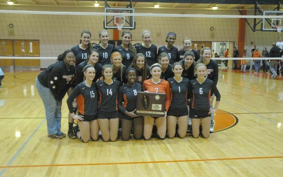 The Edwardsville Tigers pose with their Class 4A Edwardsville Sectional plaque. EHS defeated Minooka and advanced to tonight's Normal Community Super-Sectional.
