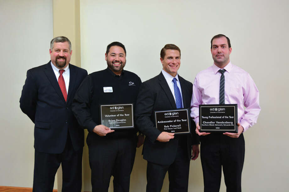 From left are: Paul Millard, 2013 board chairman, vice president of the commercial banking group at TheBANK of Edwardsville; Brian Douglas, Volunteer of the Year award, works for ONEWAY Construction; Rob Pickerell, Ambassador of the Year award, works for First Clover Leaf Bank and Chandler Vandenberg, Young Professional of the Year award, works for SIUE.