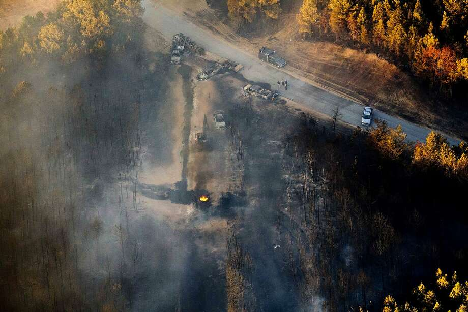 A flame burns after a pipeline explosion in Helena, Ala. The blast, which sent thick smoke soaring over a forest, happened about a mile from where the pipeline ruptured in September. Photo: Brynn Anderson, Associated Press