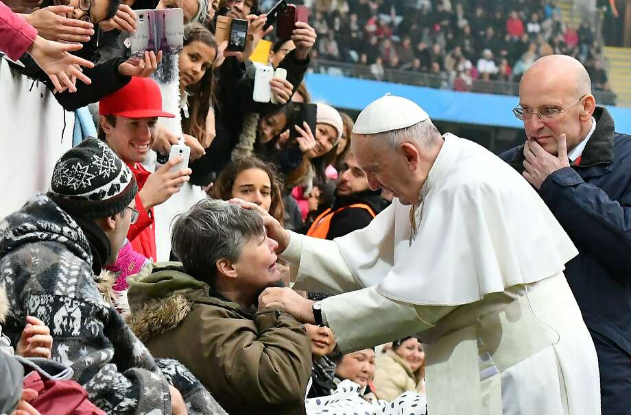 Pope Francis greets a well-wisher at a sports stadium in Malmo, Sweden, where he held a Mass. In his homily, he focused on a theme of unity. Photo: VINCENZO PINTO, AFP/Getty Images