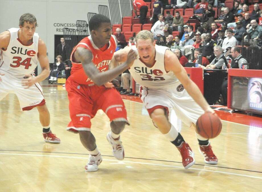 SIUE's Mark Yelovich, right, drives against Austin Peay's Josh Terry at the Vadalabene Center. The Governors defeated the Cougars 80-67. Yelovich was a key cog in the team's success this year.