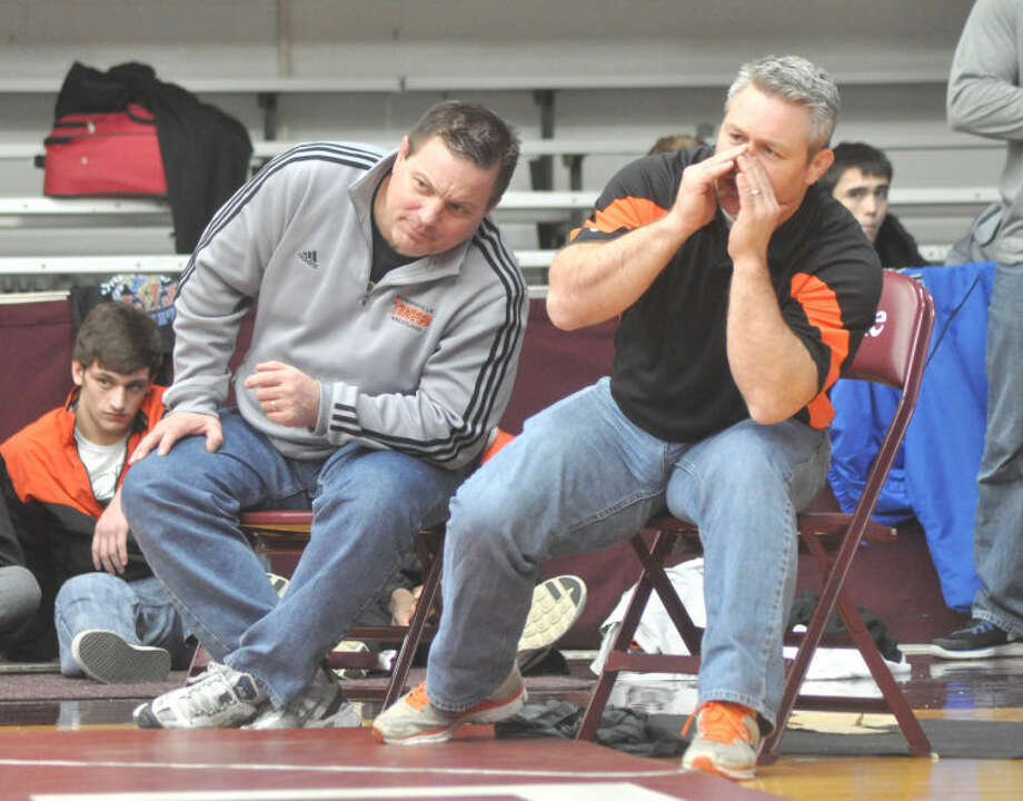 Edwardsville Tiger head coach Jon Wagner, left, and assistant coach Kevin Matarelli, right, look on during a 2012-13 match.
