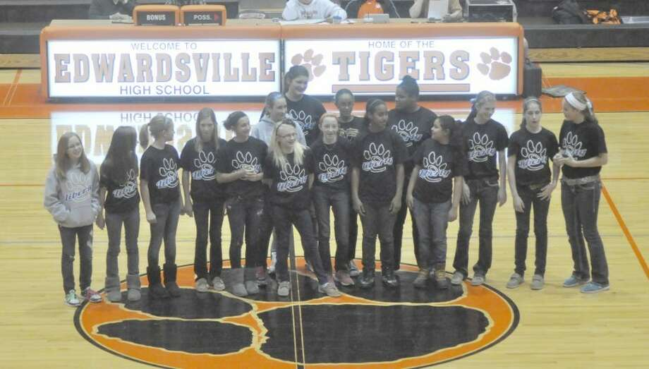 The Liberty Middle School seventh grade girls' basketball team was honored during halftime of Tuesday's girls' varsity game between Edwardsville and Granite City.