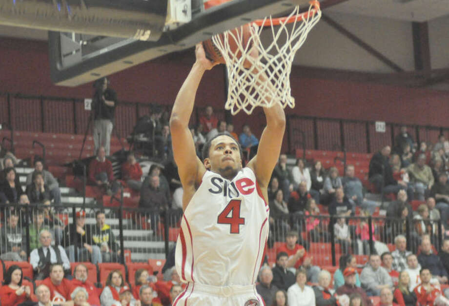 SIUE's Tim Johnson completes an alley-oop early in the second half against Austin Peay State University on Saturday at the Vadalabene Center. The Cougars lost 83-71.