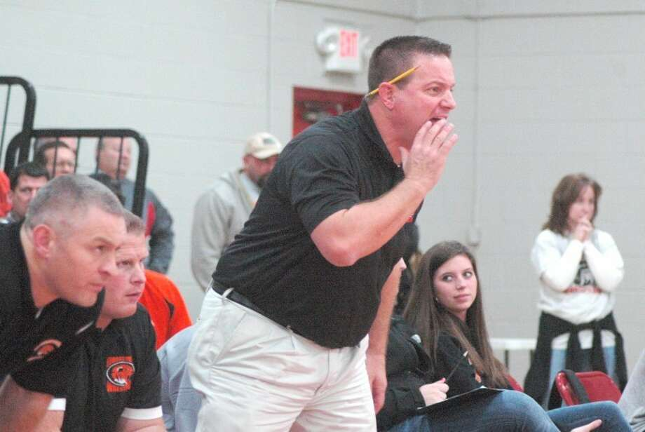Edwardsville Tiger head wrestling coach Jon Wagner yells out instructions during a dual at Granite City on Dec. 15. Wagner is ready to lead EHS on a run through the postseason beginning at 9:30 a.m. Saturday in the Class 3A Edwardsville Regional.
