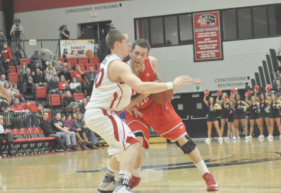 Austin Peay's Anthony Campbell, a senior, tries to keep his dribble against SIUE's Michael Messer.