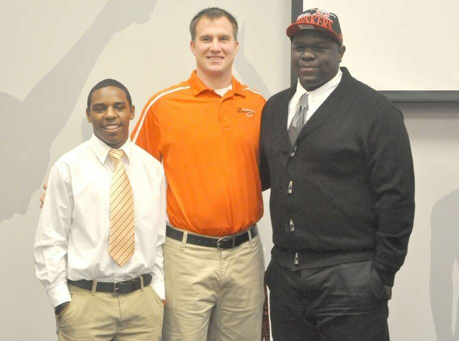Edwardsville Tiger football player Vincent Valentine made his long awaited announcement on where he would attend college at 1 p.m. Wednesday at the Jon Davis Wrestling Center, choosing the University of Nebraska. Teammate Cameron James joined Valentine at the press conference, announcing he will attend McKendree University to play football and run track. Pictured from left to right are: James, EHS head football coach Matt Martin and Valentine.