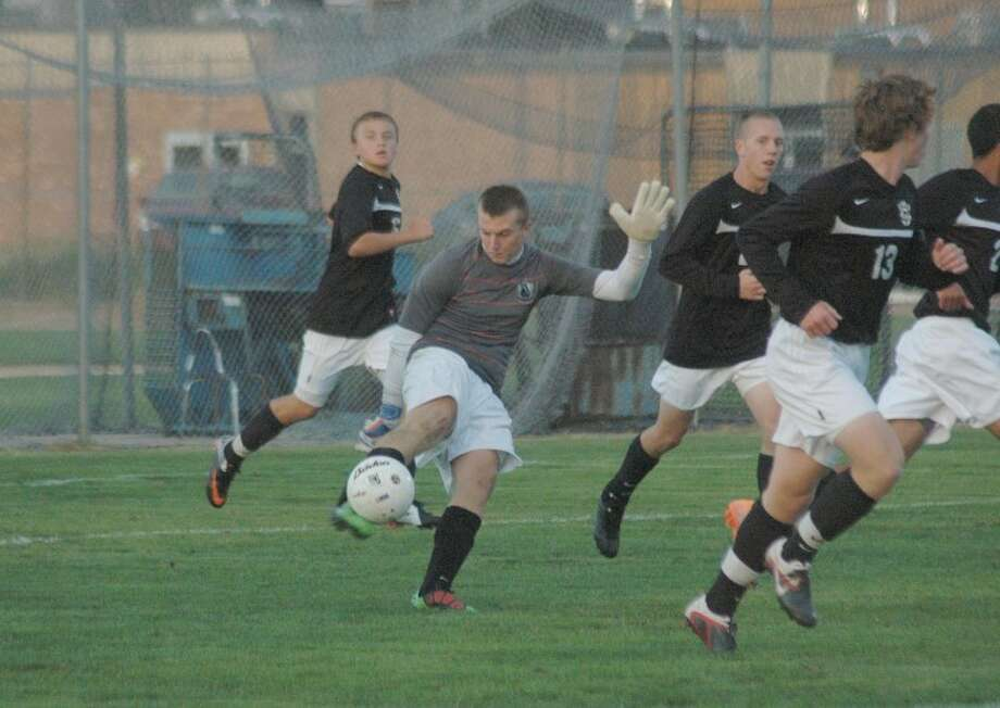 Tiger goalkeeper Daniel Brennan punts a ball out of the box after making a save against Peoria Notre Dame on Sept. 24.