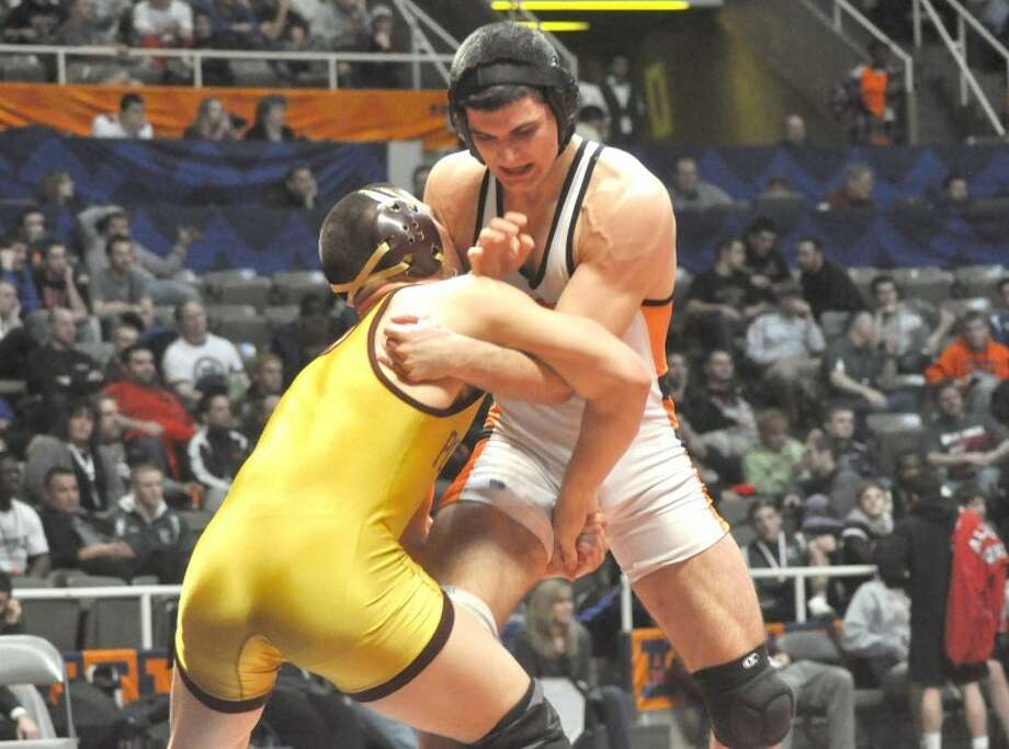 Edwardsville Tiger Blake Blair jockeys for position against Lockport's Brad Johnson in the Class 3A 195 pound state final match Saturday at Assembly Hall in Champaign. Blair lost 3-0 to finish second in the state.