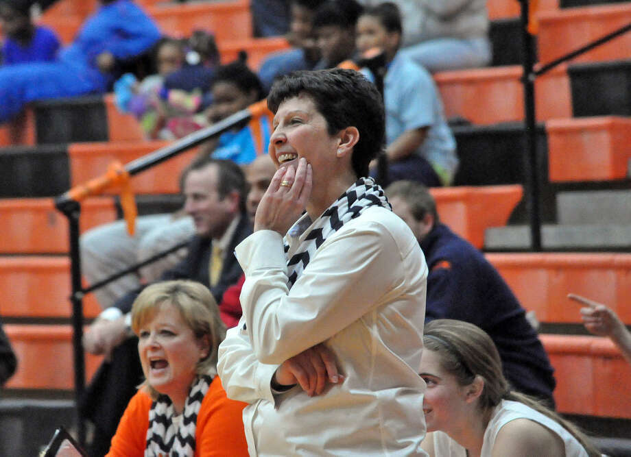 Edwardsville girls' basketball coach Lori Blade is all smiles during her team's win over East St. Louis to clinch the Southwestern Conference title on Thursday.