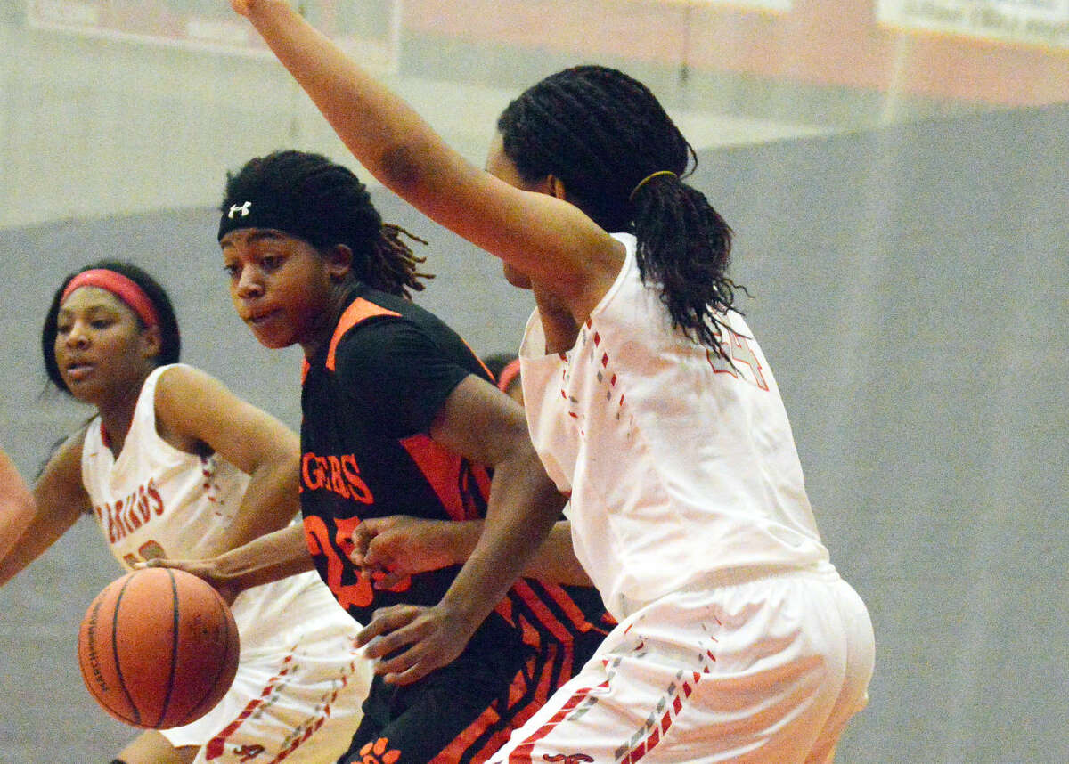 Edwardsville's Criste'on Waters, left, tries to find room for a shot in the paint.