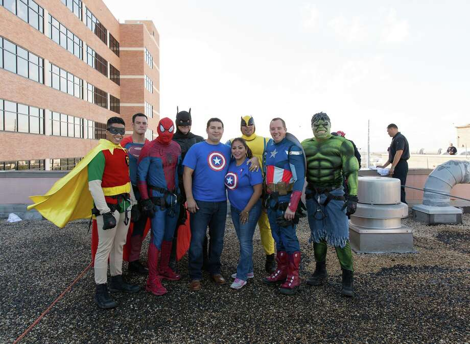 "Members of the San Antonio Fire Department and the San Antonio Police Department's SWAT unit participated in the third-annual ""Superhero Drop,"" in honor of a 5-year-old boy who lost his battle with cancer in 2015. Photo: San Antonio Police Department"