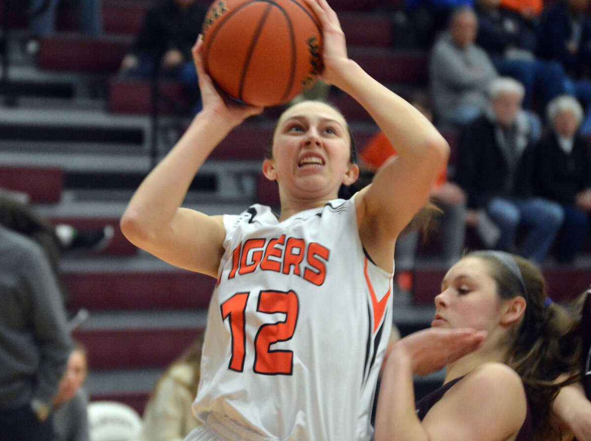 EHS guard Makenzie Silvey tries a contested shot near the baseline.