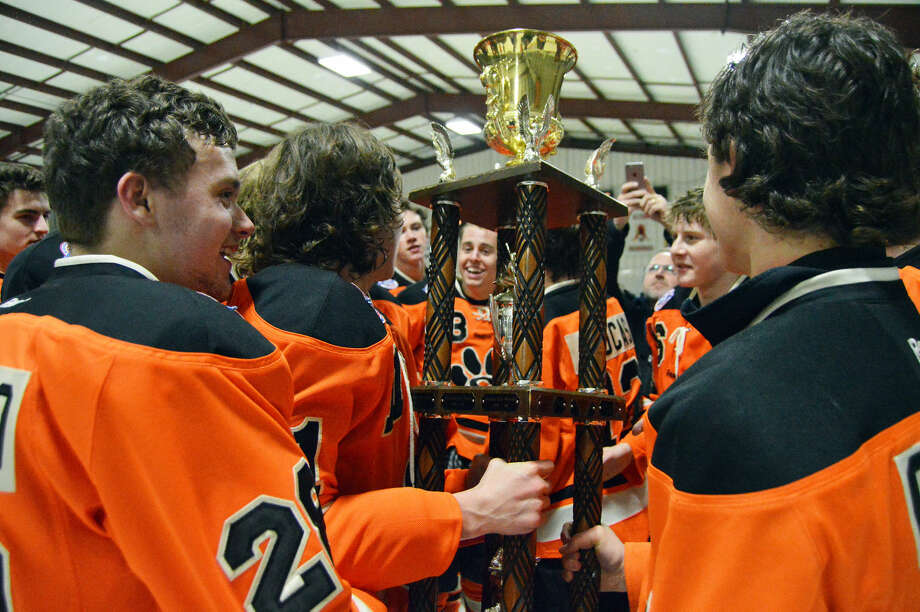 The Edwardsville ice hockey team celebrates after winning the MVCHA Class 2A championship for a fifth straight year.