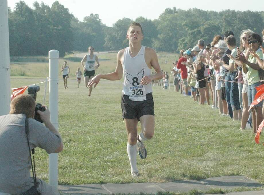 Eric Johannigmeier of Edwardsville crosses the finish line at Mud Mountain on the campus of SIUE in first place with a time of 16:30.05.