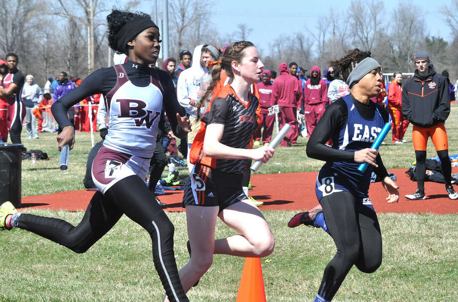 Edwardsville freshman Lorie Cashdollar, center, runs the anchor leg of the sprint medley relay during the Southwestern Illinois Relays, held March 28 at EHS.