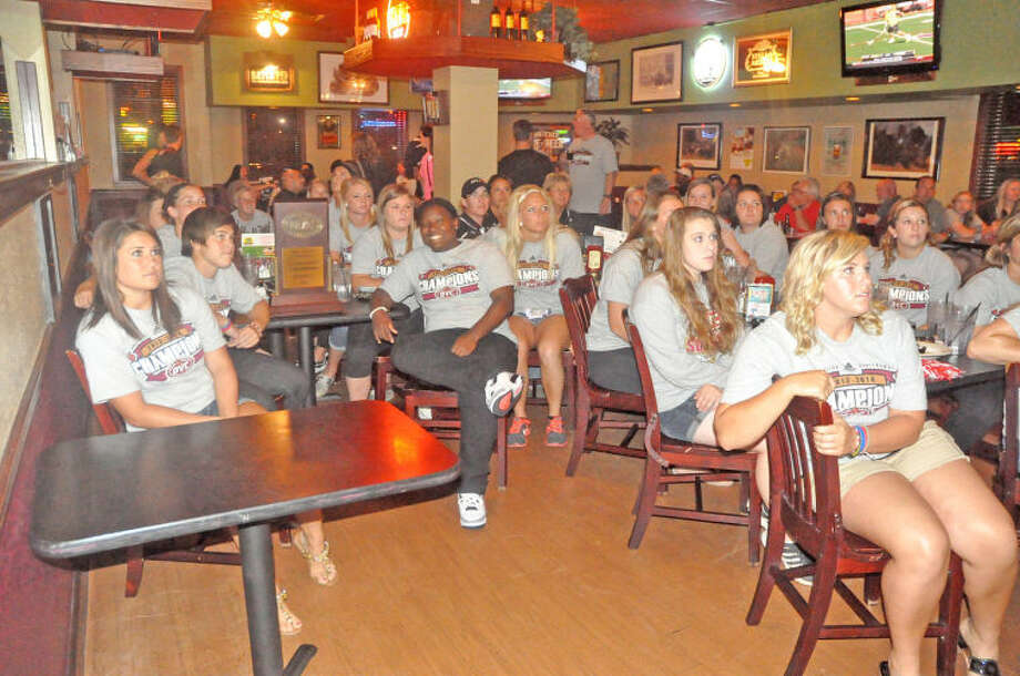 The SIUE softball team intently waits at Bull and Bear Bar and Grill on Sunday to see when, where and who they would play in the NCAA Tournament. The Cougars will face host Alabama at 6 p.m. on Friday to open the Alabama Regional.