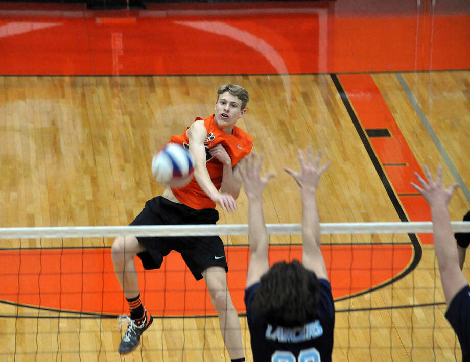 Edwardsville senior outside hitter Will Frank goes for a kill during a match this season. Photo: Matthew Kamp/For The Intelligencer