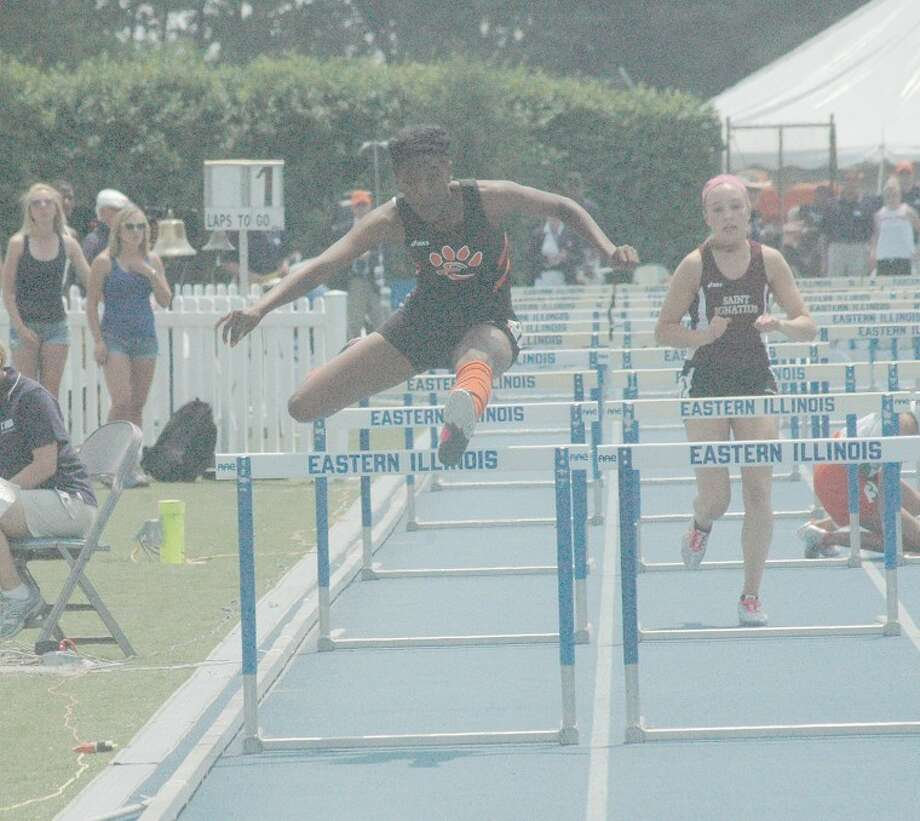 Edwardsville's Kristen Dowell completes her final hurdle in the 100 meter hurdles at the Class 3A girls' track and field state championship on Saturday in Charleston.