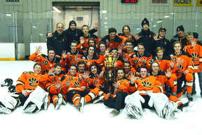 Members of the Edwardsville ice hockey team celebrate with the Mississippi Valley Club Hockey Association championship trophy after winning a fifth consecutive league title.