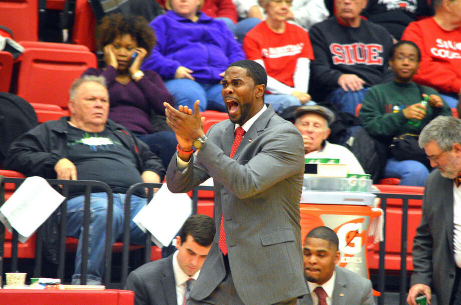 SIUE men's basketball coach Jon Harris yells instructions to his team during the Cougars' season-ending 80-75 to Austin Peay on Feb. 25 at the Vadalabene Center.