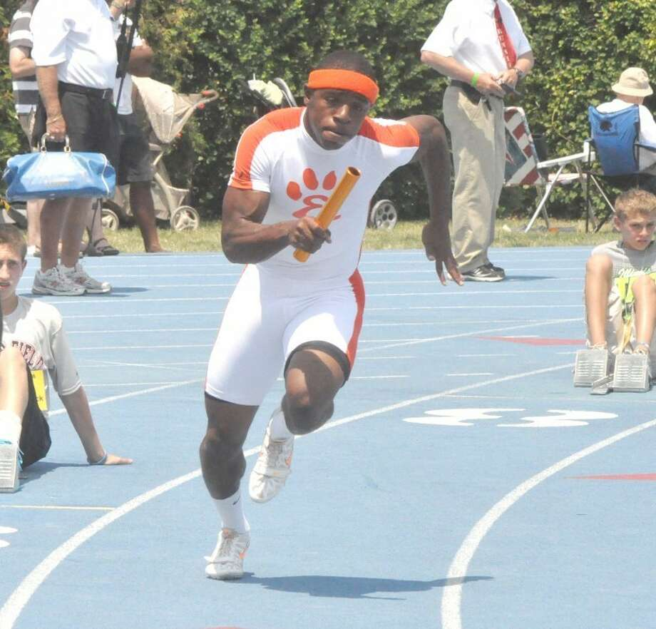 Edwardsville Tiger Cameron James runs the lead leg of the 400 meter relay team on Saturday in the Class 3A state track and field meet on Saturday at Eastern Illinois' O'Brien Stadium.