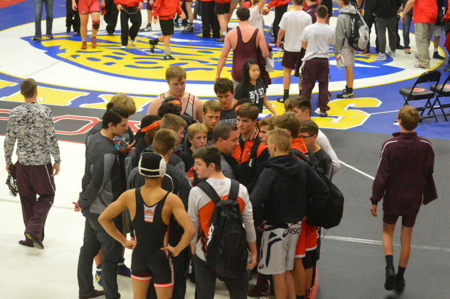 The Edwardsville wrestling team listens to coach Jon Wagner before a dual in the Ron Sauer Wrestling Tournament.