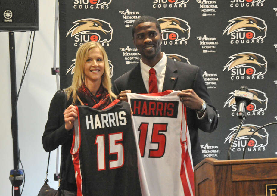 SIUE men's basketball coach Jon Harris, right, and his wife Heidi hold up SIUE basketball jerseys during Tuesday's formal introduction of the eighth head coach in program history. Harris is a 1998 graduate from Edwardsville High School. Photo: Matthew Kamp For The Intelligencer