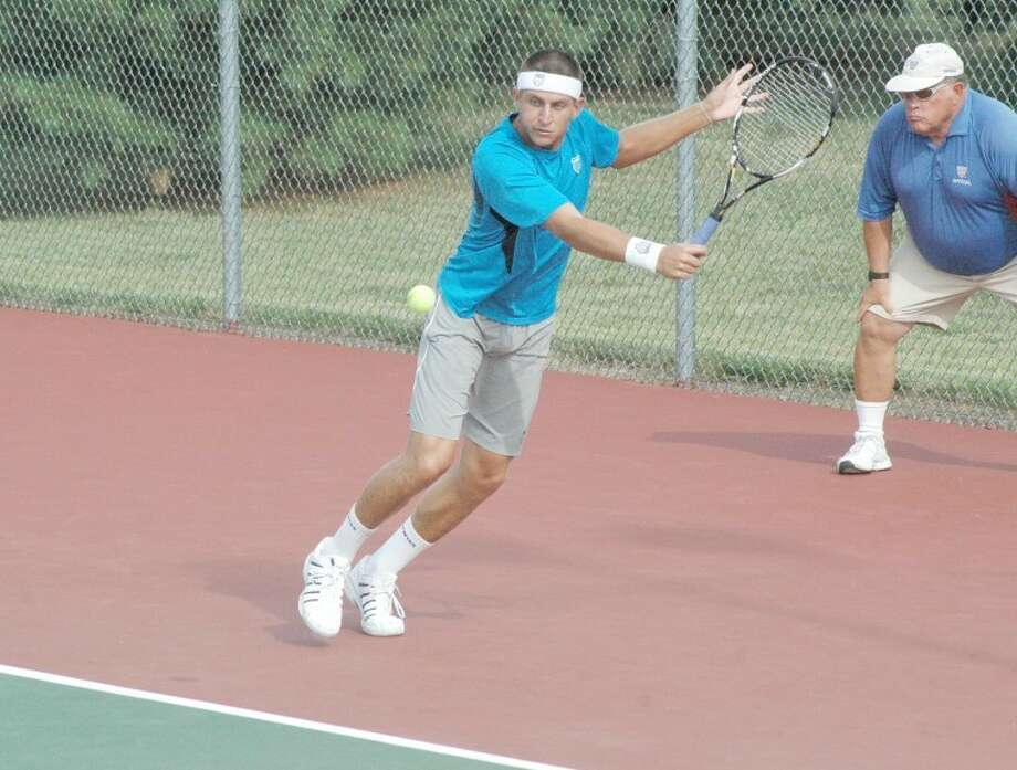 Devin Britton lunges for a backhand return during singles action on Wednesday at the EHS Tennis Center in the Edwardsville Futures Tournament. Britton was the 2009 NCAA singles national champion while playing at the University of Mississippi.