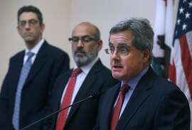 City Attorney Dennis Herrera announces at a City Hall news conference that the state's bail schedule is unconstitutional and won't defend it in a lawsuit filed against the sheriff's department in San Francisco, Calif. on Tuesday, Nov. 1, 2016. Standing with Herrera is deputy city attorney Jeremy Goldman (left) and chief deputy Ronald Flynn.