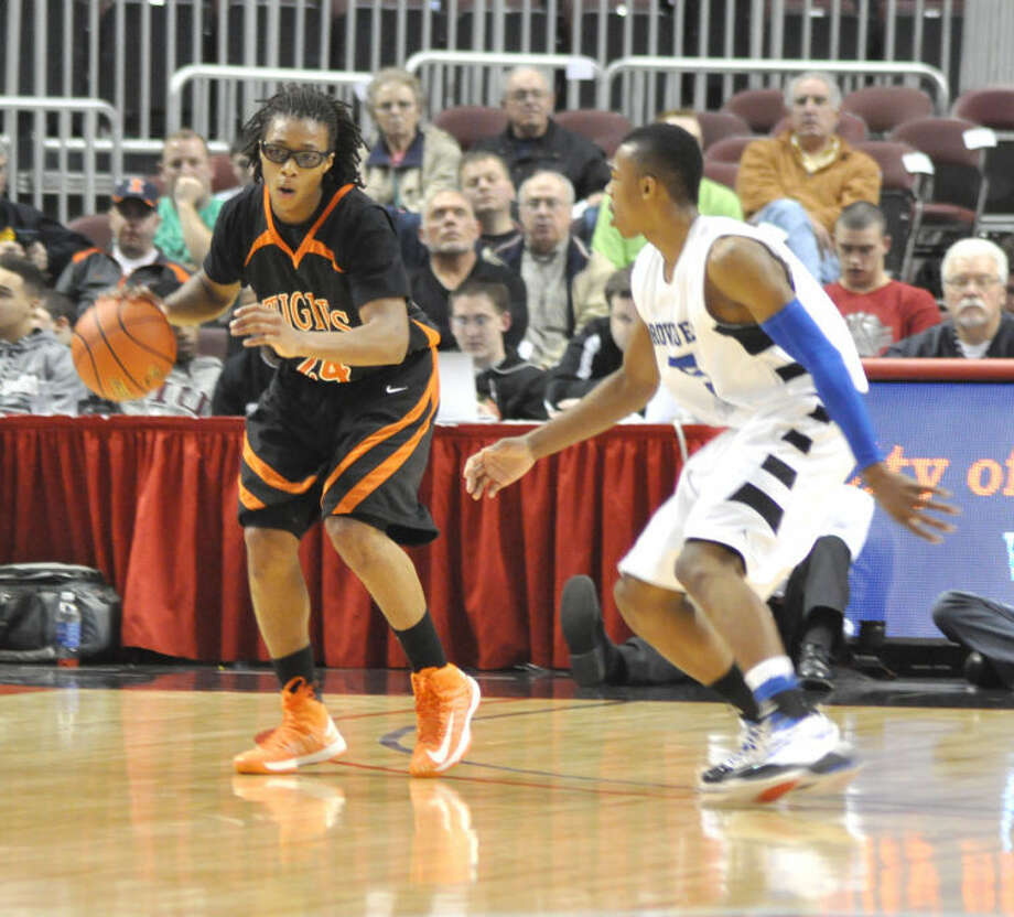 Edwardsville's Shawn Roundtree brings the ball up court against Proviso East Saturday in the Class 4A third place game at the state tournament in Peoria.