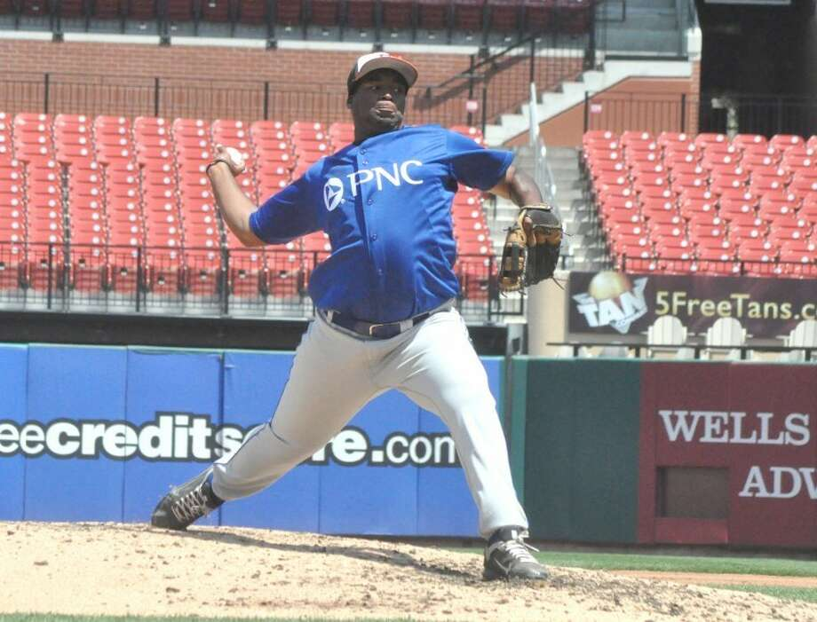 Edwardsville's Jevon Boyd delivers a pitch at Busch Stadium during third inning action Monday in the third annual PNC Bank High School Baseball Showcase sponsored by Rawlings.